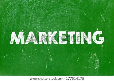 Marketing handwritten on blackboard - stock photo