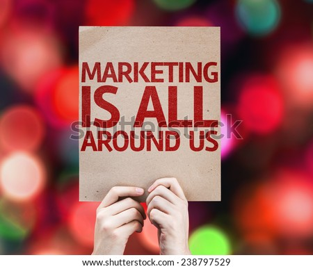 Marketing is All Around Us card with colorful background with defocused lights - stock photo