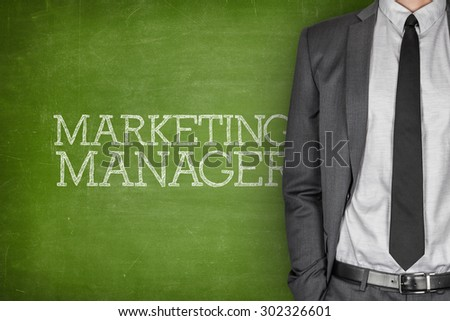 Marketing manager on blackboard with businessman in a suit on side - stock photo