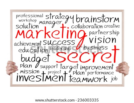 marketing secret and other related words handwritten on whiteboard with hands - stock photo