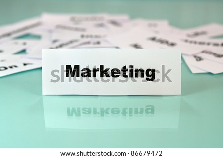 Marketing sign or word on a piece of paper - stock photo
