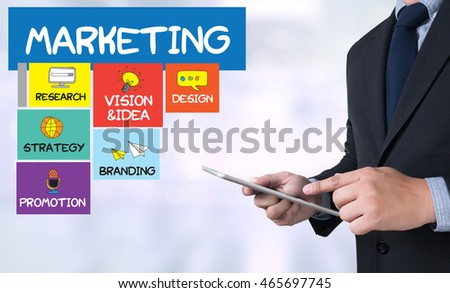 MARKETING STRATEGY Businessman use a tablet computer