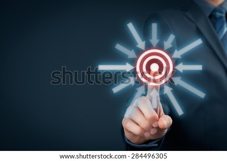 Marketing targeting, goal and trigger concepts. Businessman click on virtual target.