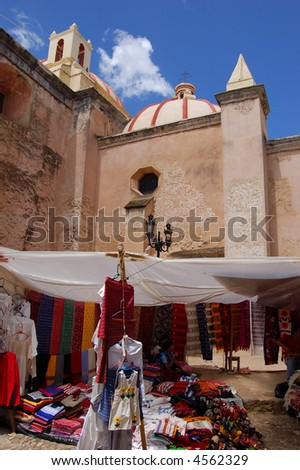 Marketplace With Church in Background - stock photo