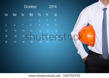 marking day on the October 2014 calendar. - stock photo
