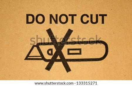 Marking do not cut on cardboard box - stock photo