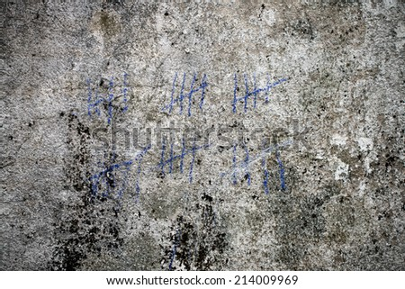 marking for counting on the grunge wall - stock photo
