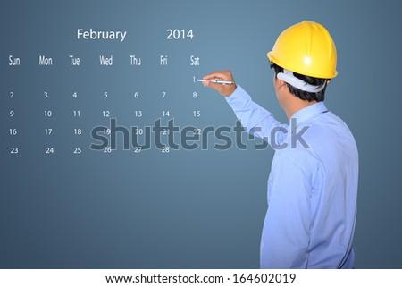 marking new year day on calendar February 2014. - stock photo