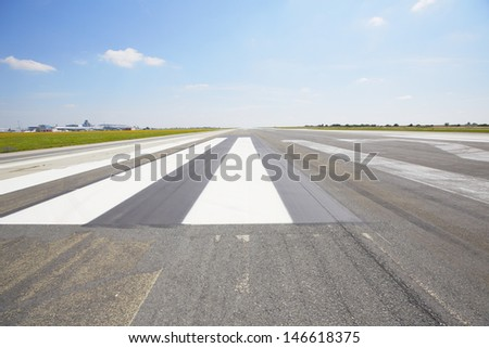 Marking on the beginning of the runway - selective focus - stock photo