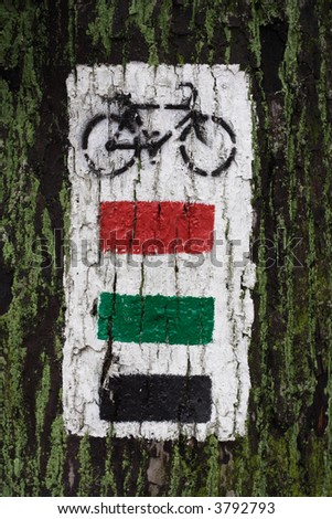 Marking paint of the touristic bike trail. - stock photo