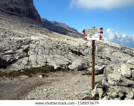 Marking the path Alfredo Benini in the Brenta Dolomites mountains in Italy, unique landscapes and unforgettable experience. - stock photo