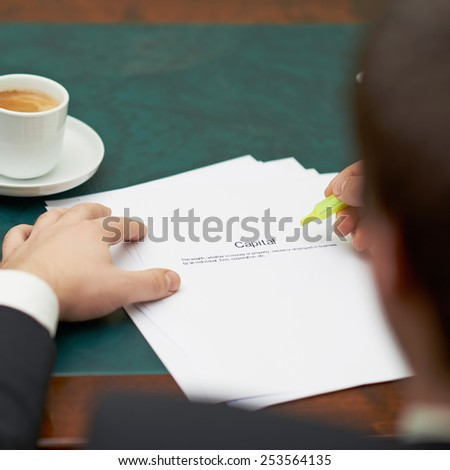 Marking words in a capital definition, shallow depth of field composition - stock photo