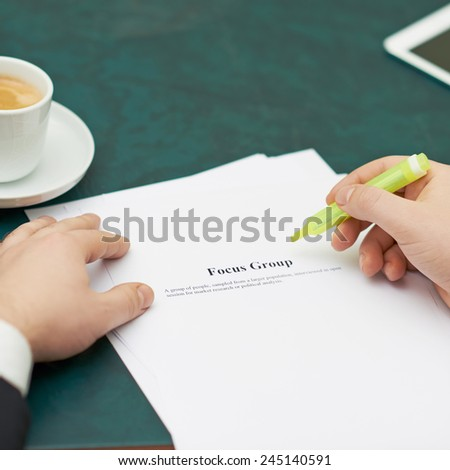 Marking words in a focus group definition, shallow depth of field composition - stock photo