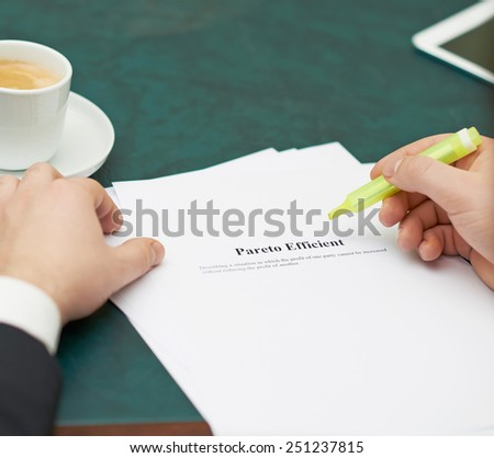 Marking words in a Pareto efficient definition, shallow depth of field composition - stock photo