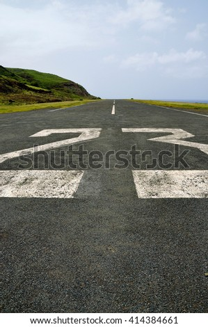 Markings on an airport runway found on the town of Faja D'Agua on the island of Brava, Cabo Verde.