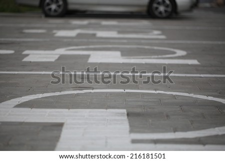 markings on the asphalt parking for disabled - stock photo