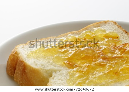 Marmalade on slice of bread