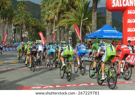 MARMARIS, TURKEY - APRIL 30, 2014: Riders on the finish of 4th stage of 50th Presidential Cycling Tour of Turkey. It is the only intercontinental cycling stage race from Europe to Asia - stock photo