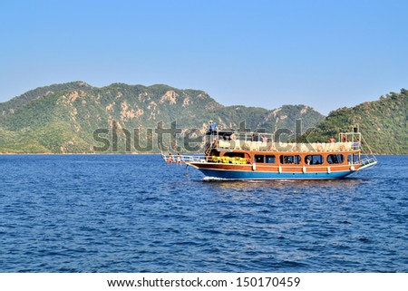 MARMARIS, TURKEY - JULY 24, 2013: Turkish houseboat with tourists at a popular Mediterranean resort on July 24, 2013 in Marmaris, Turkey. - stock photo