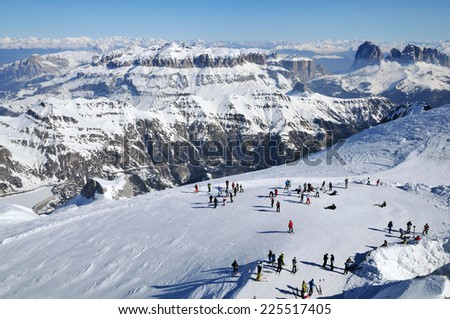 MARMOLADA, ITALY - NOVEMBER 1: Skiers enjoy the first ski day of the year as Marmolada ski area of Italian Dolomities open its ski-trucks on November 1, 2010 in Marmolada, Italy - stock photo