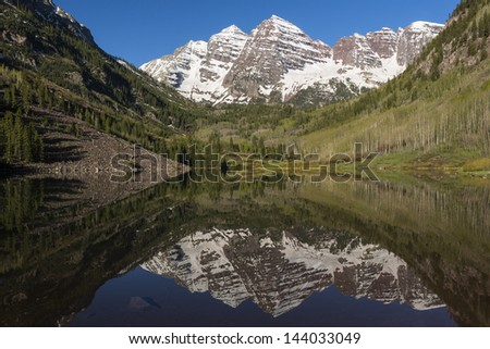 Maroon Bell Mountains and Lake - stock photo