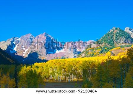 Maroon Bells and Aspen Grove - stock photo