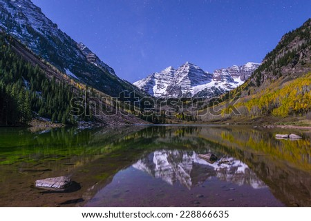 Maroon Bells and its Reflection in the Lake with Fall foliage in Peak at Aspen, Colorado - stock photo