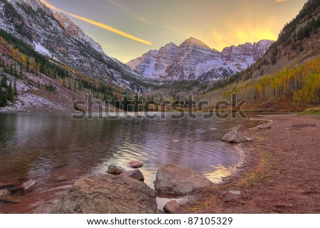 Maroon Bells in late afternoon light, from Maroon Lake - stock photo