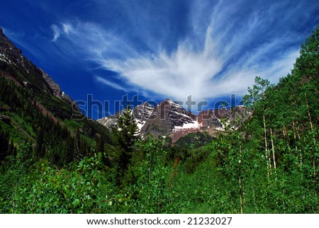 Maroon Bells Mountain Peaks in the summer with a majestic sky - stock photo