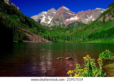 Maroon Bells Mountain Peaks in the summer with Maroon Lake in foreground - stock photo