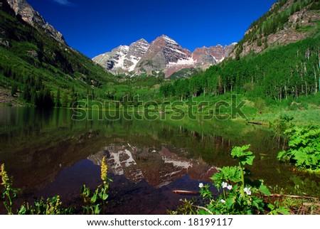 Maroon Bells Peaks at Maroon Lake near Aspen Colorado - stock photo