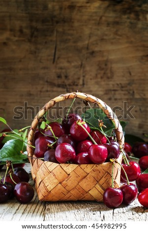Maroon cherry in a basket, selective focus