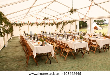 Marquee decorated, tables laid, guests awaited - stock photo
