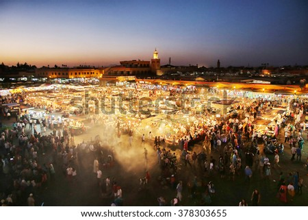 Marrackech,Morocco - 12 August 2014 : Famous Djemaa El Fna Square in early evening light, Marrakech, Morocco with the Koutoubia Mosque, Northern Africa.