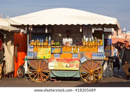 MARRAKECH, MOROCCO - APR 29, 2016: Orange juice stall on the Jamaa el Fna square in Marrakesh. - stock photo