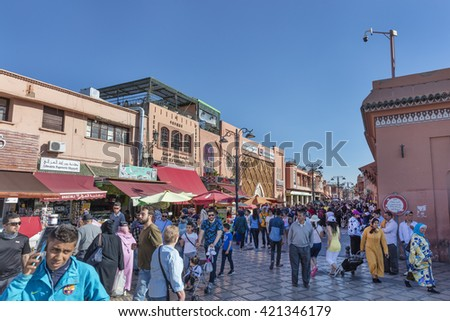 MARRAKECH, MOROCCO - APRIL 23, 2016: Busy street near Jamaa el Fna  square and market place in Marrakesh's medina quarter    - stock photo