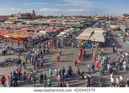 MARRAKECH, MOROCCO - APRIL 23, 2016: Jamaa el Fna (Jemaa el-Fnaa, Djema el-Fna or Djemaa el-Fnaa) square and market place in Marrakesh's medina quarter Marrakesh, - stock photo