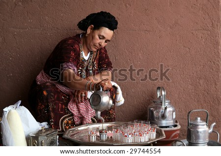 MARRAKECH, MOROCCO - AUGUST 8 : A Berber woman performs the traditional ceremony of making mint tea on August 8, 2008 in Marrakech, Morocco. - stock photo