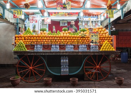 MARRAKECH, MOROCCO - FEBRUARY 22, 2016: Orange juice stall on the Jamaa el Fna square (also Jemaa el-Fnaa, Djema el-Fna or Djemaa el-Fnaa) in Marrakesh. - stock photo