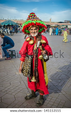 MARRAKECH, MOROCCO-26, MARCH: water peddler in the Djemaa El Fna on 26, march, 2013, in Marrakech, Morocco. The square is part of the UNESCO World Heritage. - stock photo