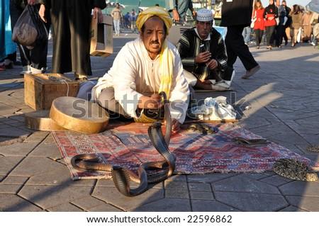 MARRAKECH, MOROCCO - NOV 22:  Snake charmer at Djemaa el Fna square.  November 22, 2008 in Marrakech, Morocco - stock photo