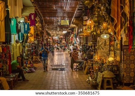 Marrakech, Morocco - 30 October 2015: A typical Friday atmosphere at the aisles Souk in Marrakesh Medina - stock photo
