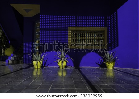 Marrakech/ Morocco - October 31st 2014: Bright, contrasting colours. Architecture in the Majorelle Gardens, named after their creator, the French painter Jacques Majorelle. - stock photo