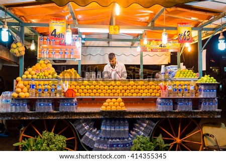 MARRAKECH, MOROCCO - OCTOBER 20, 2015: Unidentified man working on stand selling orange juice in Djemaa el Fna square central Marrakech, Morocco. - stock photo