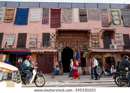 MARRAKECH, MOROCCO - OCTOBER 27, 2015:  Unidentified people at Marrakech medina near the UNESCO square Djemaa El-fna at Marrakesh, Morocco - stock photo