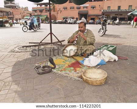 MARRAKECH - OCT 20 : Snake charmer at Djemaa el Fna square. October 20, 2009 in Marrakech, Morocco. UNESCO declared the Jemaa el Fna intangible cultural heritage of humanity. - stock photo