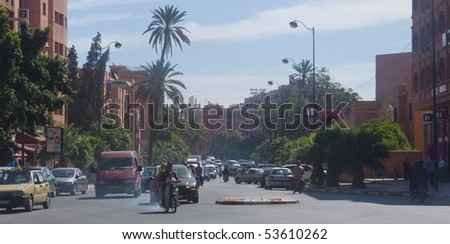 MARRAKESH - APRIL 19: Street in the centre of the city Marrakesh with smog April 19, 2010 in Marrakesh, Morocco. - stock photo