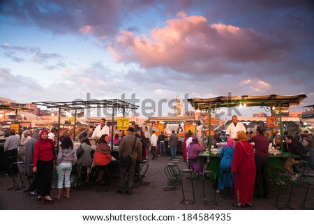 MARRAKESH - February 9,2013: Unknown people trade in the area and buyers, is a square and market place in medina quarter (old city). Marrakesh, Morocco, north Africa. UNESCO Heritage of Humanity.  - stock photo