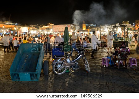 MARRAKESH - JULY 14: Unidentified people sells food in Jemaa el Fna Square at dusk, July 14, 2013 in a Marrakesh, Morocco. The square is part of the UNESCO World Heritage - stock photo