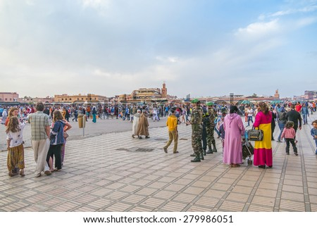 MARRAKESH, MOROCCO, APRIL 4, 2015: People gather in Jemaa el-Fnaa square - stock photo